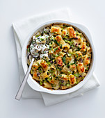 Rigatoni gratin with burrata, broad beans and olives