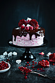 Raspberry cake with chocolate meringues and pomegranate for Christmas