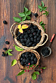 Fresh blackberries in wicker baskets