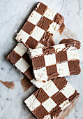 Slices of vanilla and chocolate checkerboard ice cream