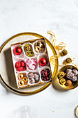 Fruit and sweets for Christmas in boxes and bowls