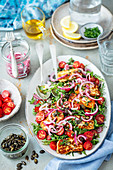 Arugula and cherry tomato salad with halloumi cheese