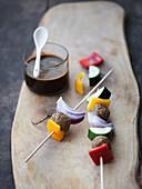 Vegetable skewers with teriyaki sauce