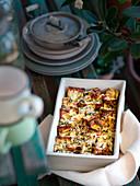 Ricotta squares au gratin with herbs