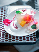 Fruits in coconut water aspic with ginger