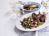 Lamb chops with asparagus and butterbeans