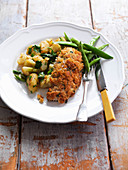Pork schnitzel with crushed potatoes
