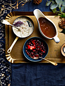 Buttery bread sauce, Port and cranberry sauce, Rich wine gravy