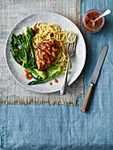 Chinese-inspired chicken breast with plum ketchup and steamed greens