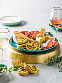 Basil pesto palmiers and cheese platter
