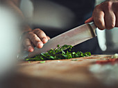 Chopping fresh herbs with a knife