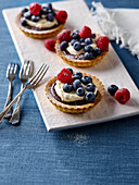 Summer chocolate berry tarts
