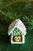 Gingerbread houses decorated with white royal icing for Christmas