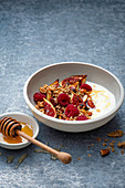 Roasted figs with honey, cinnamon, yogurt, fresh rasberries and toasted nuts and oats