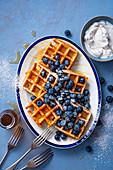 Homemade waffles with honey, blueberries and greek yoghurt