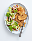 Chicken escalope in a white wine sauce with an apple salad