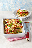 Maultaschen lasagne with tomato sauce and basil