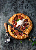 Almond and plum crostata with ice cream
