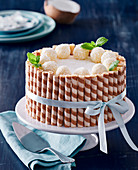 Coconut gateau with filled tubes