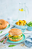 Vegeterian burger with hummus, zucchini and egg cutlet