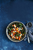 Warm red lentil penne salad with chilli pumpkin and tahini dressing