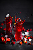 Strawberry, rhubarb and cherry drink with ice