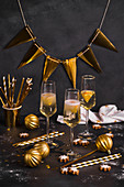 New Years Eve champagne glasses with golden decorations