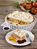 Scheiterhaufen (bread bake with apples, cinnamon, raisins and almonds) with a meringue topping