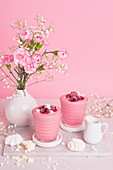 Pink smoothie with yoghurt, raspberries and meringues
