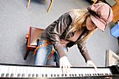 Music student playing piano
