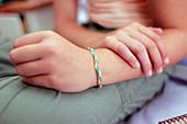 Girl wearing friendship bracelet
