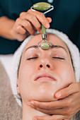 Jade stone roller face massage
