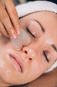 Guasha jade face sculpting massage