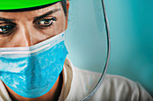 Exhausted medical worker in PPE