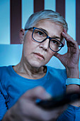 Woman with insomnia watching television
