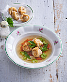 Vegetable broth with crunchy liver gnocchi