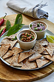 Tomato and wild garlic dip and a kidney bean dip served with nachos