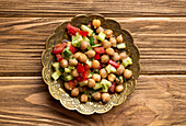 Indian healthy salad with chickpeas and vegetables