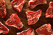 Raw lamb chops with salt and pepper