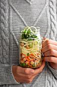 Girl Holding Noodle Jar