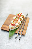 Inside-out sushi with tuna and avocado