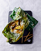 Sticky rice with pineapple in a banana leaf