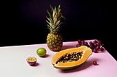 Tropical fruits still life with mango, papaya, pitahaya, passion fruit, grapes, lime and pineapple