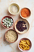 Grains, legumes and pasta in bowls