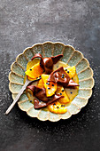 Orange and passion fruit soup with chocolate ravioli