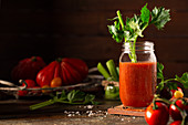 Tomato juice garnished with a stick of celery