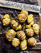 Hasselback potatoes with a wooden sign