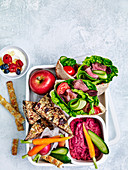Pita bread with steak, beetroot hummus and muesli bars