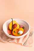 Poached Peaches in white wine, vanilla and basil