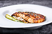 Steak of salmon in honey glaze with black and white sesame seeds